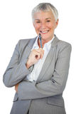 Smiling businesswoman holding pen Royalty Free Stock Image