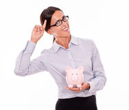 Smiling businesswoman holding pink piggy bank Royalty Free Stock Photo