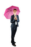 Smiling businesswoman holding pink umbrella Royalty Free Stock Photography