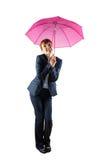 Smiling businesswoman holding pink umbrella Stock Photos