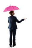 Smiling businesswoman holding pink umbrella Royalty Free Stock Image