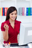 Smiling businesswoman holding a red apple Royalty Free Stock Images