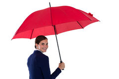 Smiling businesswoman holding red umbrella Royalty Free Stock Photos
