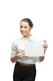 Smiling businesswoman holding sign Royalty Free Stock Photos