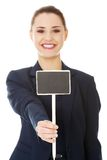 Smiling businesswoman holding small empty board Stock Image