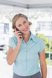 Smiling businesswoman holding smartphone Royalty Free Stock Photos