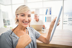 Smiling businesswoman holding a tablet Stock Photos
