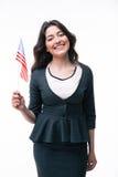 Smiling businesswoman holding US flag Royalty Free Stock Photos