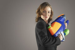 Smiling Businesswoman Holding Water Gun Stock Photography