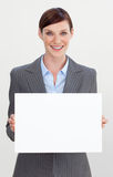 Smiling businesswoman holding white card Stock Photos
