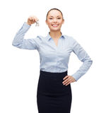 Smiling businesswoman with house keys Royalty Free Stock Photo