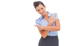 Smiling businesswoman indicating something Stock Photo