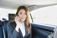 Smiling Businesswoman inside her car talking on the mobile phone Stock Photo