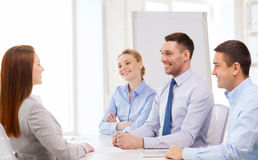 Smiling businesswoman at interview in office Stock Images