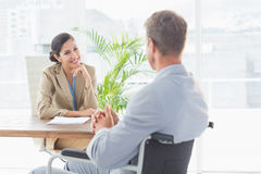 Smiling businesswoman interviewing disabled candidate Royalty Free Stock Photos