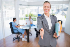 Smiling businesswoman introducing herself Royalty Free Stock Photography