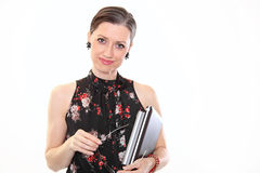 Smiling businesswoman with laptop. Mature business woman holding a laptop Stock Image