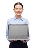 Smiling businesswoman with laptop blank screen Stock Photography