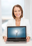 Smiling businesswoman with laptop computer Royalty Free Stock Photography