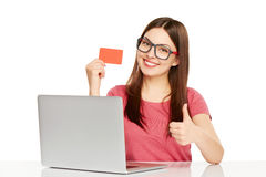 Smiling businesswoman with laptop and credit card stock photography