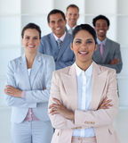 Smiling businesswoman leading her team Royalty Free Stock Image