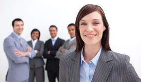Smiling businesswoman leading her team Royalty Free Stock Photos