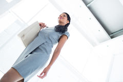 Smiling businesswoman leaving the office Royalty Free Stock Photo