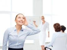 Smiling businesswoman listening gossig Stock Image