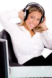 Smiling businesswoman listening music Stock Photo