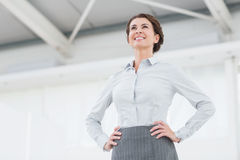 Smiling businesswoman looking away Stock Photos