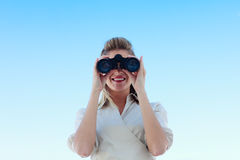 Smiling businesswoman looking through binoculars Stock Photos