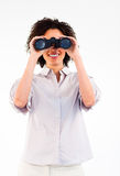 Smiling businesswoman looking through binoculars Royalty Free Stock Image