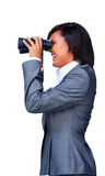 Smiling businesswoman looking through binoculars Stock Photography