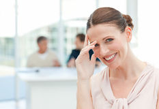 Smiling businesswoman looking at the camera Stock Photos