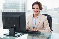 Smiling businesswoman looking at camera Stock Images