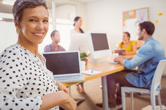 Smiling businesswoman looking at the camera Stock Photography