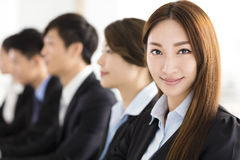 Smiling businesswoman looking at camera with  colleague. Smiling business women looking at camera with  colleague Royalty Free Stock Images