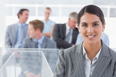 Smiling businesswoman looking at camera during conference Royalty Free Stock Image