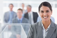 Smiling businesswoman looking at camera during conference Stock Photography