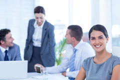 Smiling businesswoman looking at camera Royalty Free Stock Photo