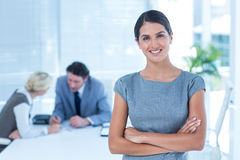 Smiling businesswoman looking at camera Stock Photos