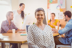 Smiling businesswoman looking at the camera Royalty Free Stock Photos