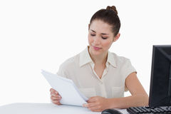 Smiling businesswoman looking a document Royalty Free Stock Photo
