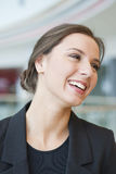 Smiling businesswoman looking off camera Stock Images