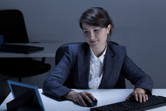 Smiling businesswoman looking at picture Stock Images