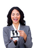 Smiling businesswoman looking at a thumb index Royalty Free Stock Images