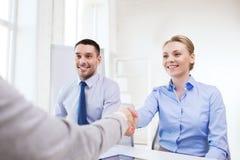 Smiling businesswoman making handshake in office Royalty Free Stock Photos