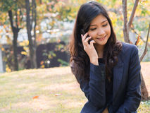 Smiling businesswoman making a phone call Royalty Free Stock Image