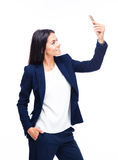 Smiling businesswoman making selfie photo Stock Images