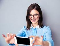 Smiling businesswoman making selfie photo Stock Photo